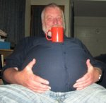 15.  Can you balance a mug on your belly and drink out of it.jpg