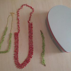 Some beadwork I made. The red necklace is a mix of reds seedbeads. The green bracelet and necklace is peridot gem chips and seedbeads. (The silver me