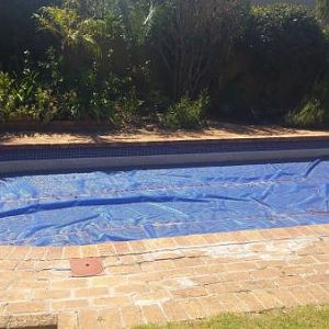 Water Restrictions 2017 & 2018 -- Covering our pools to prevent evaporation.