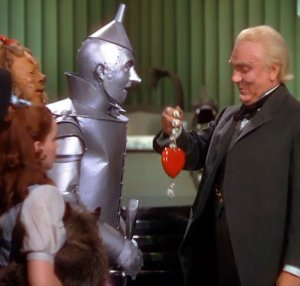 Wizard of Oz giving heart to Tin Man.jpg
