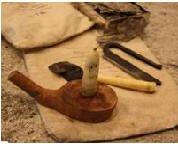beeswax candle on limb holder.jpg