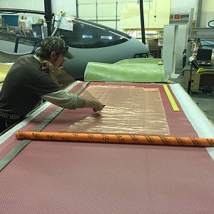 copper mesh is cut for carbon-compatible lightning strike protection as we prepare wing skins for layup