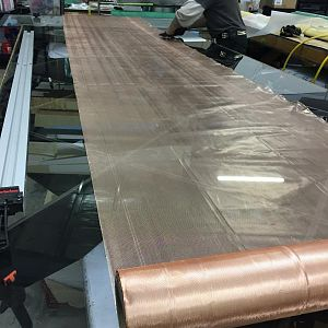 expanded copper microgrid is cut for wet wing tank protection