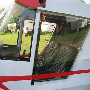 Lexan doors with red trim on the bottom. Looks like they will provide good visibility.