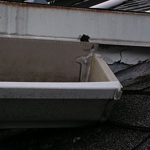 Gutter is supported on one end by the roof