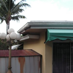 A downspout ran down the wall near the shed