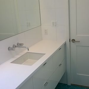 Ikea cabinet, wall tile, corian top