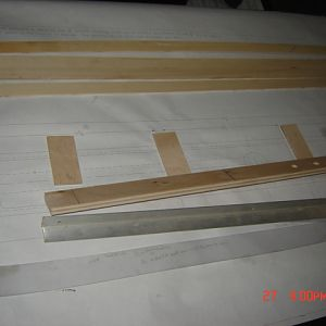 tub rails are cut and drilled