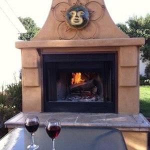 Outdoor Fireplace we built so we can sit outside on cool days & nights and enjoy our wine.